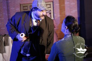 Chairman Barnes (Consulting Detective) and Clara Huggins (Hannah Whiteoak). Heidi Marie Photography